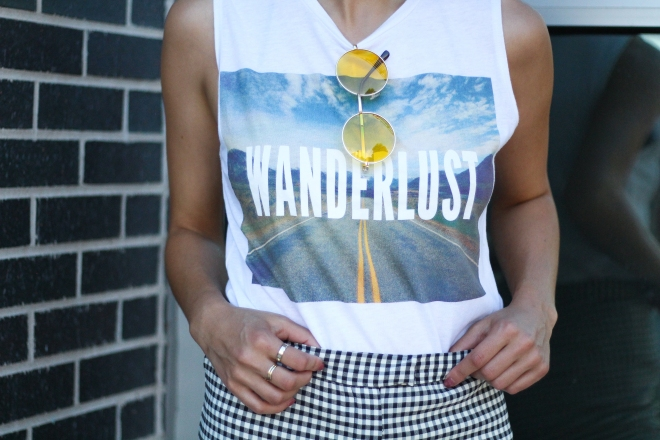 yellow sunglasses and graphic tank