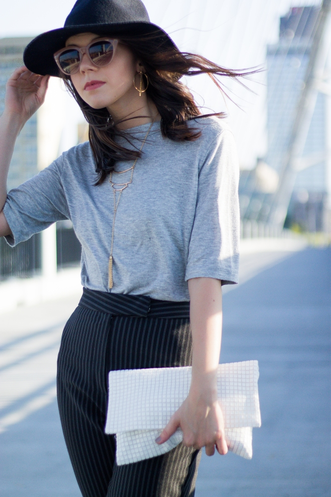 Gray Tee, Black Hat, Striped Pants, and White Clutch