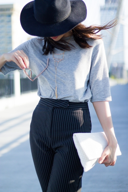 Fashion Outfits: Gray Tee, Black Hat, Striped Pants, and White Clutch